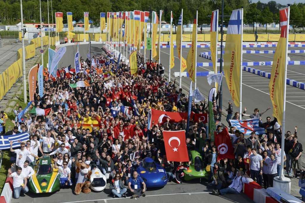 Participants line up for the group photo during practice day 2 of the Shell Eco-marathon Europe 2015 in Rotterdam, Netherlands, Thursday, May 21, 2015. (Patrick Post/AP Images for Shell)